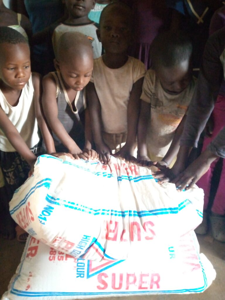 Orphans are happy about the donations, which were used to buy maize flour.