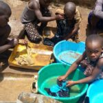 Washing clothes - One day at Orphans of Uganda Children Center