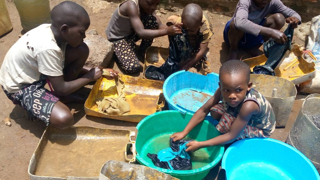 Washing clothes – One day at Orphans of Uganda Children Center